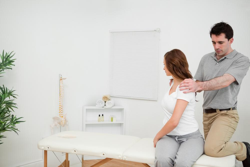Woman seeing Cirmingham Chiropractor for Pain management
