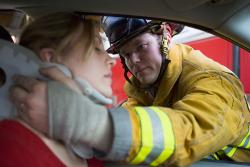 Firefighter in Birmingham helping a young female in an auto accident